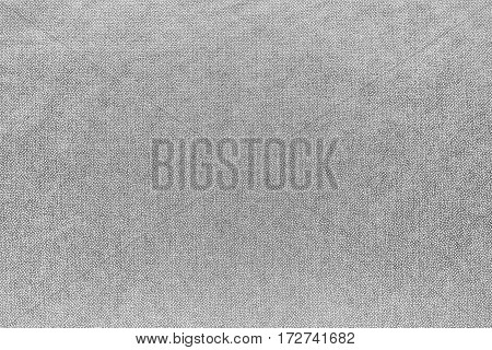abstract background and speckled or mottled texture of fabric or textile material of pale color