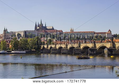 Old Town and Charles Bridge over Vltava river in Prague .