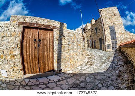 Sunny street in a small mediterranean village. Lofou Limassol District Cyprus.