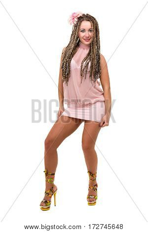 Portrait of Sexy young woman in a little dress, with dreadlocks and flower, isolated on white background