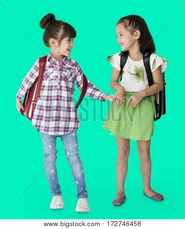 Two girls with a backpack