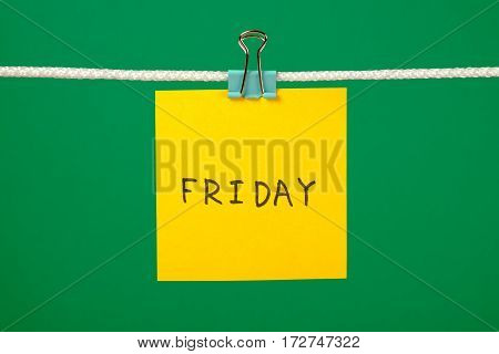 Yellow Paper Note On Clothesline With Text Friday