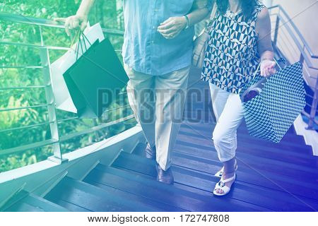 Photo Gradient Style with Senior couple climbing upstairs shopping