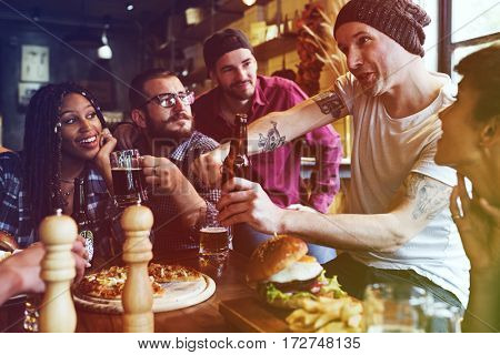A group of friends at a party talking