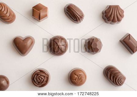 Filled Chocolate / Sweets seen from above with white background and smooth lightning.
