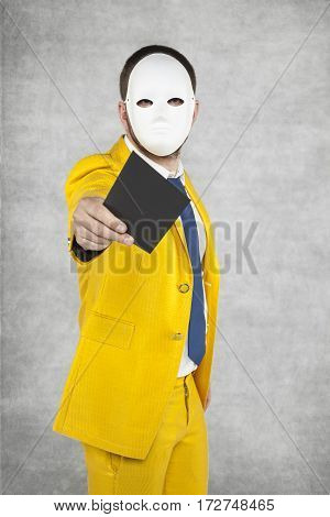 Businessman In A Suit Giving A Golden Envelope As A Gift