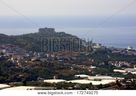 Beautiful views of the city, the sea and the mountain suburb of Alanya, Mahmutlar, Turkey.