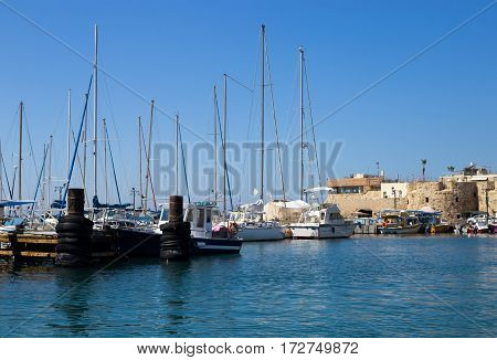 Sailboats Moored at the marina in Akko Israel. Nobody on the pier at summer day