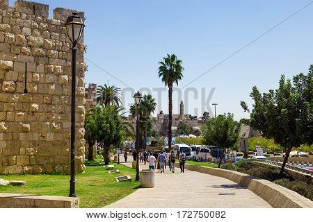 JERUSALEM ISRAEL - CIRCA SEP 2016: Old walls of Jerusalem with people entering Jaffa gate