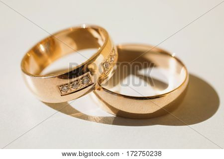 Wedding rings on a white background, wedding bands infinity sign of the rings