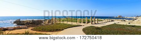 Columns of the ancient Roman Villa on the Mediterranean coast in Caesarea Israel. Panoramic photo in high size