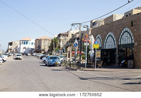 ACRE ISRAEL - CIRCA SEP 2016: A street in Akko (Acre) Israel. City street with cars residentil houses and cafe in the Old Ciyt of Acre- Israel