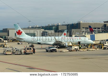 Fort Lauderdale, FL, USA - DEC. 25, 2014: Air Canada Embraer 190 at Fort Lauderdale - Hollywood International Airport, Fort Lauderdale, Florida, USA.