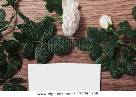 Mock up frame of red and white roses and red hearts on wooden background. Greeting card. Conceptual photography. Wedding invitation card. Valentine day. Flat lay top view copyspace mock up