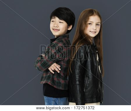 Two kids standing back to back portrait