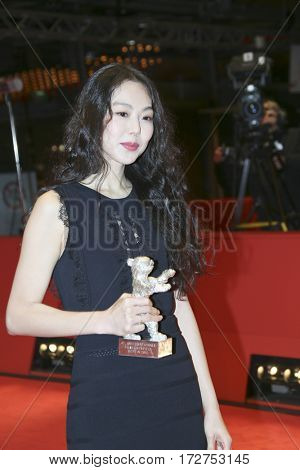 Kim Min-hee poses the Silver Bear award for best actress after the closing ceremony of the  Berlinale International Film Festival Berlin at Berlinale Palace on February 18, 2017 in Berlin, Germany.