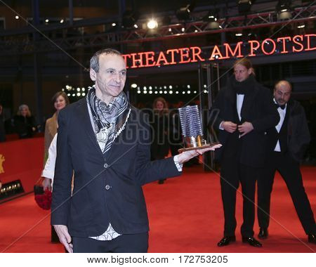 Winner for the Glashuette Original Documentary Award Raed Andoni poses with the award at the closing ceremony of the Film Festival Berlin at Berlinale Palace on February 18, 2017 in Berlin, Germany.