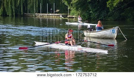 ST NEOTS, CAMBRIDGESHIRE, ENGLAND - JULY 24, 2016: Close up of Female Sculler, Newark Club on the River Ouse at St Neots.