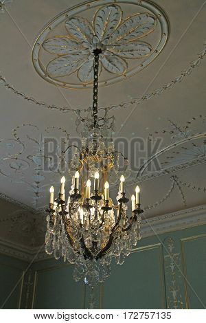 Classic Lighting Chandelier Hanging From a High Ceiling.