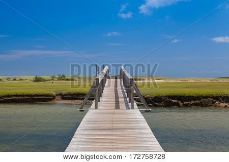 Sandwich Massachusetts USA - July 14 2016: Famous walkway to the dunes.The walkway was destroyed by Hurricane Bob in 1991 but was rebuilt via private donations. In Sandwich Cape Cod Massachusetts USA