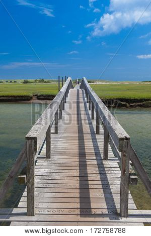 Sandwich Massachusetts USA - July 142016: Famous walkway to the dunes.The walkway was destroyed by Hurricane Bob in 1991 but was rebuilt via private donations. In Sandwich Cape Cod Massachusetts USA