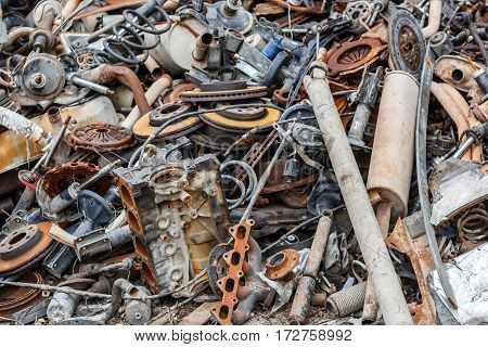 Background pile of rusted metal scrap on the open air.