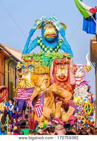 Cento Italy 19 feb 2017: Carnival of Cento satirical parade float Donald Trump as Tarzan between monkeys