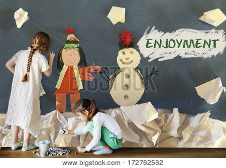 Children having fun with snowman artwork