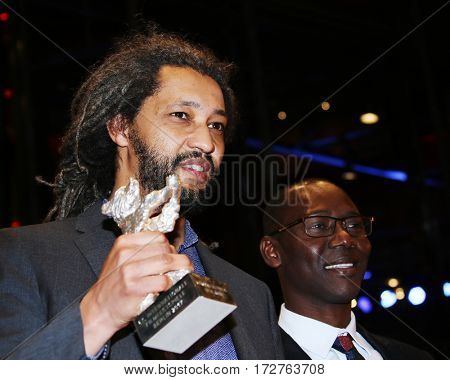 Alain Gomis holding the Silver Bear Grand Jury Prize for Felicite backstage after the closing ceremony of the 67th Film Festival Berlin at Berlinale Palace on February 18, 2017 in Berlin, Germany.