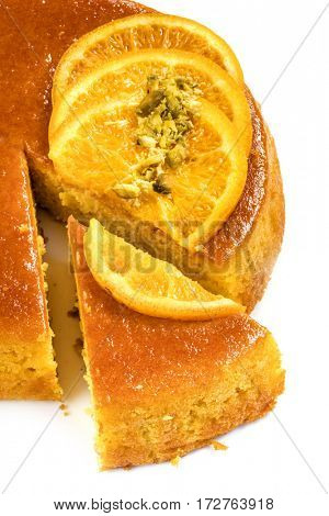 Flourless orange cake over white.  Wedge cut out.