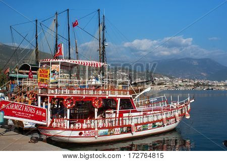 TURKEY, ALANYA - NOVEMBER 10, 2013: Small wooden ship waiting for a cruise in the Mediterranean Sea near the coast of Alanya. Boating is a very popular form of recreation in the Mediterranean.