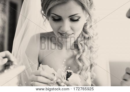 Bride Takes A View Of A Boutonniere