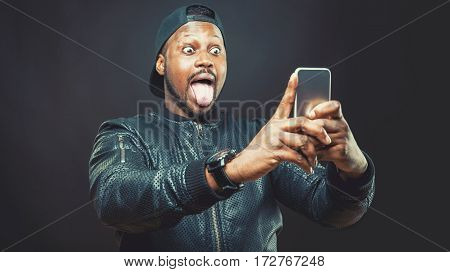 Handsome Young Man Use His Smart Phone For A Selfie Shot