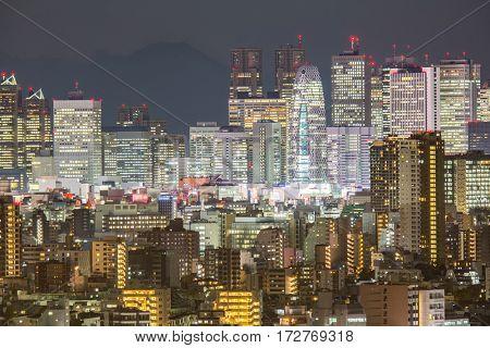 Tokyo Shinjuku Skyline cityscape night and Mountain fuji in Japan