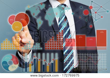 Manager touching financial data with his finger on a big touchscreen