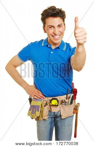 Happy handyman with tool belt holding thumbs up