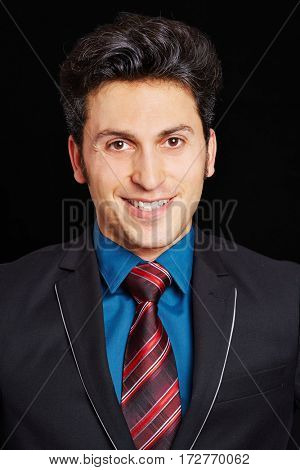 Frontal head shot of smiling young business man