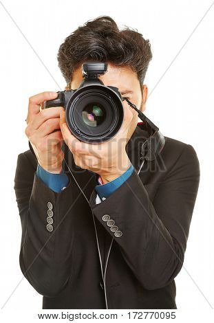 Business man taking photos with modern digital DSLR camera