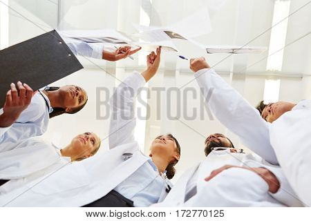Doctors analyzing and looking for diagnose with radiology team
