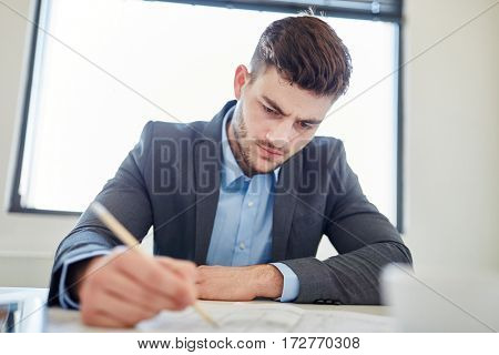 Manager working and writing a concept in concentration