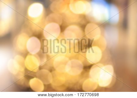 Golden Festive abstract background with bokeh defocused lights and black shadow