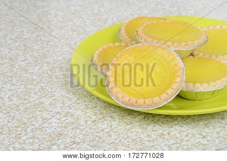 closeup lemon tarts on a green plate