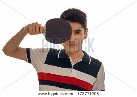 handsome sportsman practicing a table tennis with racket in hands and looking at the camera isolated on white