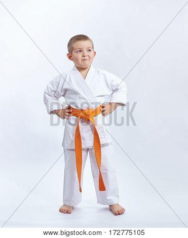 Child in karategi on a white background