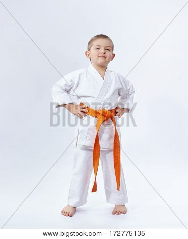 On a white background little athlete in karategi