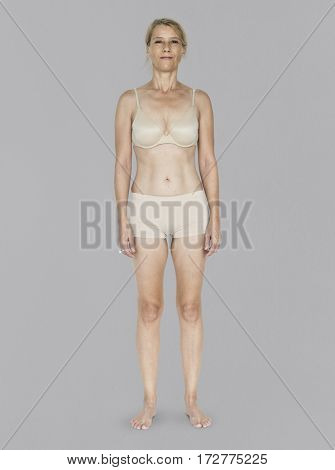 Caucasian Blonde Female Model On Gray Background