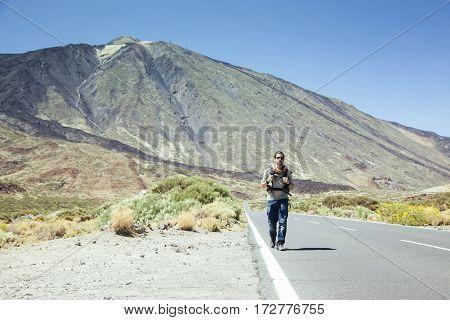 adventurous spanish mountain climber hiking the road around Teide.