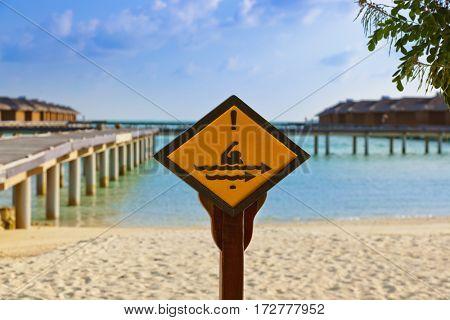 Sign on Maldives island - nature travel background