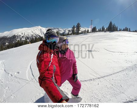 Skiers couple on skiing terrain in mountain