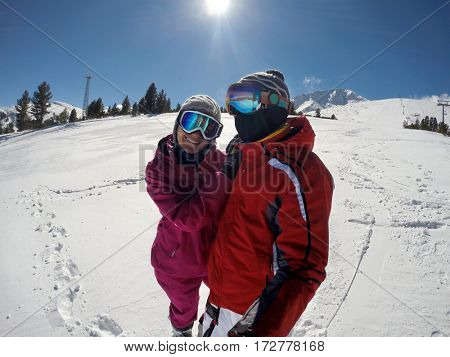 Young couple enjoying in healthy winter sport on mountain